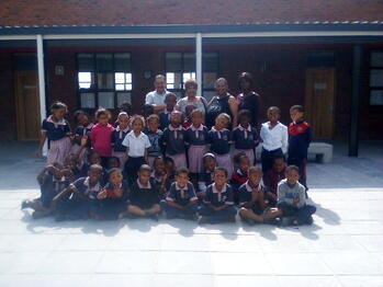 Ester and some of the team with a class of children